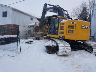 ISA Co. Excavation: Demolition Services Toronto in Snow